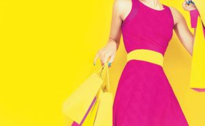 Borough Parade - Shopping - Woman with Shopping Bags on Yellow Background